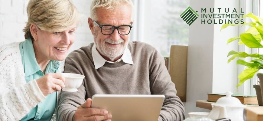Older Couple Looking at Tablet, Sell Your Mortgage Note