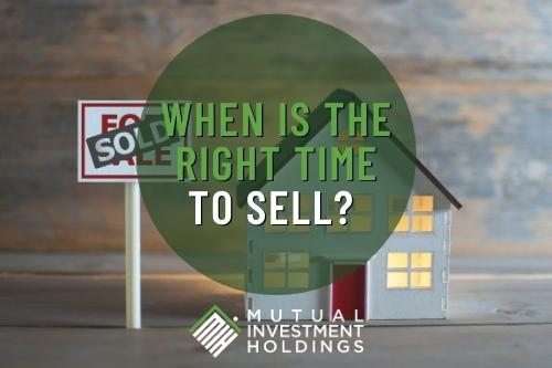 """Photo of House and Sold Sign with Words: """"When is the Right Time to Sell?"""""""