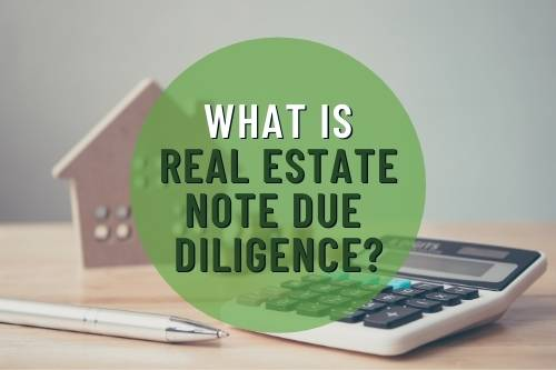 """Photo of Small Wood House and Calculator with Words: """"What is Real Estate Note Due Diligence?"""""""